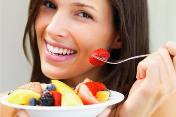 Woman eating fruit 615x409.jpg