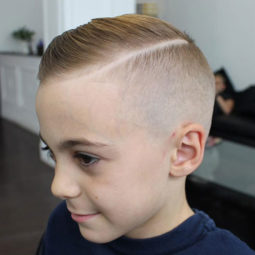 Comb over with hard part and skin fade.jpg