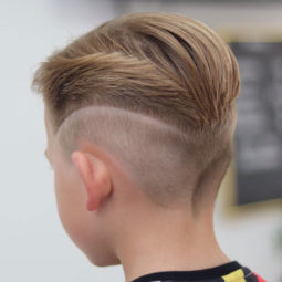 Slicked back hair with mid fade and design 1.jpg