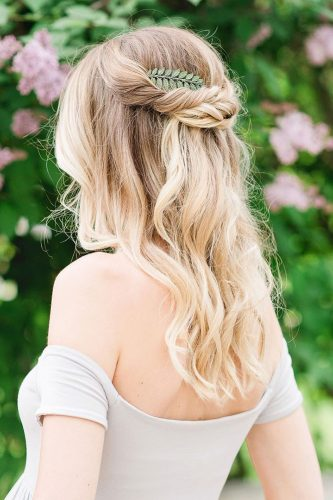 Wedding hairstyle trends half up blond hair with green topknotbrides 333x500.jpg