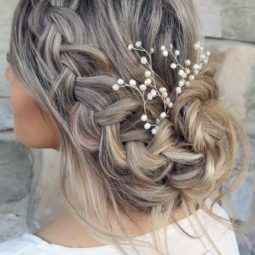 Wedding hairstyle trends low messy updo with braid karina kotok via instagram 334x500.jpg
