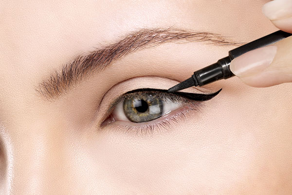 Wing your eye lines with makeup for downturned eyes.jpg
