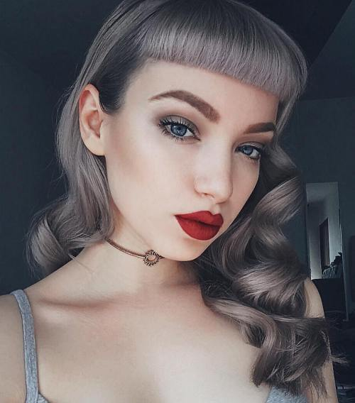 1 curly gray pin up hairstyle with bangs.jpg