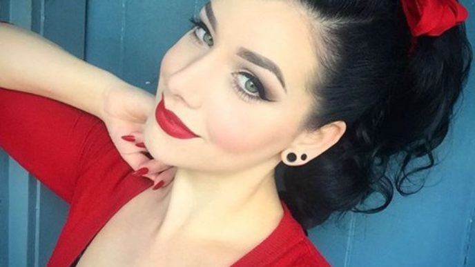 8 pin up ponytail with a red bow.jpg