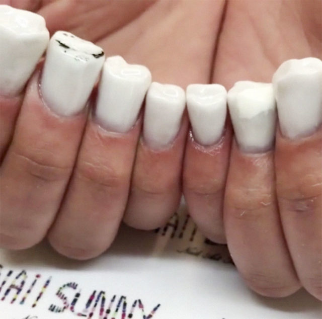Molar teeth nail art 1 5af54126be18a__700.jpg
