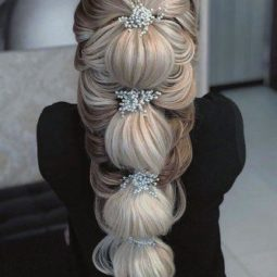 Wedding hairstyles for long hair blonde hair down hairstyle with pearls pins zahraasadi_style 334x500.jpg
