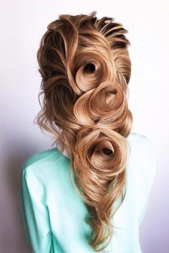 Wedding hairstyles for long hair cascading with elegant texture larisarecha 334x500.jpg