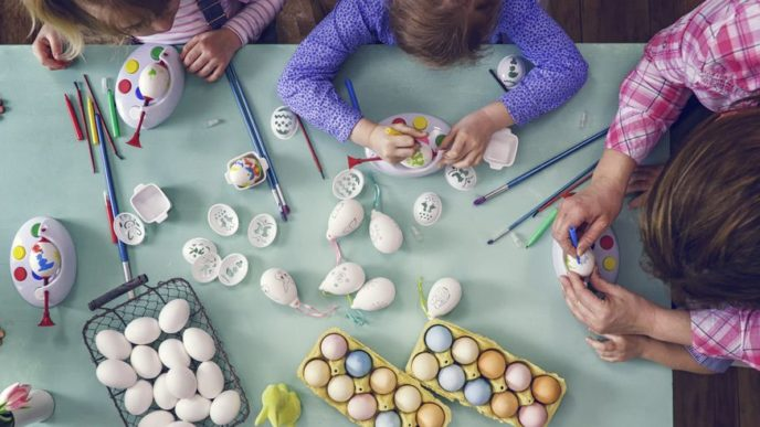 Kids painting easter eggs royalty free image 645980914 1551798969 1.jpg