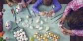 Kids painting easter eggs royalty free image 645980914 1551798969.jpg