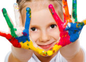 Little girl child painted hands handprints paint.jpeg