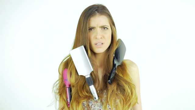 Funny woman with messy long hair unhappy about brushing slow motion_bf s kwb__f0004.png