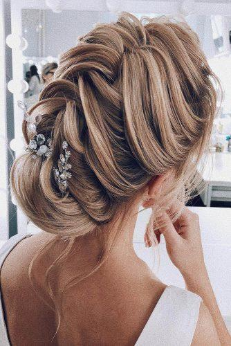 Wedding hairstyles 2019 elegant textured updo on blonde hair my_wedmakeup 334x500.jpg