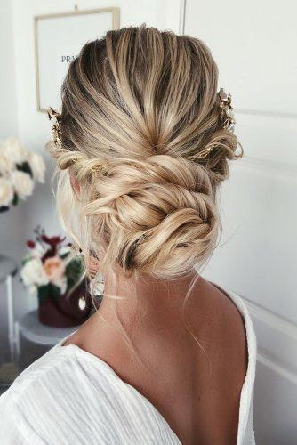 Wedding hairstyles 2019 simple low swept bun with halo on blonde hair caraclynebridal 334x500.jpg