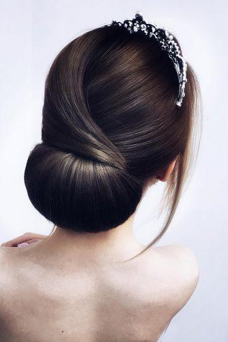 Wedding hairstyles 2019 sleek bridal chignon on dark medium hair hairstyle_by_elena_demchenko 334x500.jpg