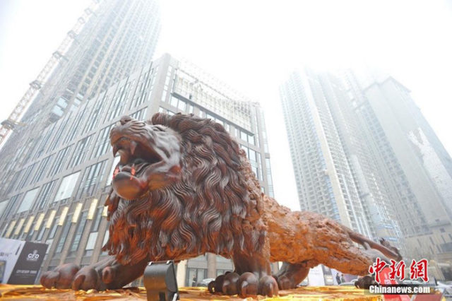 Giant lion sculpture fortune plaza times square.jpg