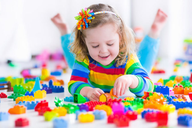 Girl playing with colorful blocks.jpg