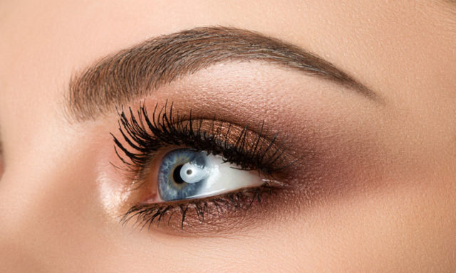 Close up of woman eye with beautiful brown smokey eyes makeup