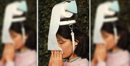 Head mounted toilet paper dispenser.jpg