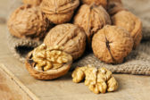 Walnuts on wood background