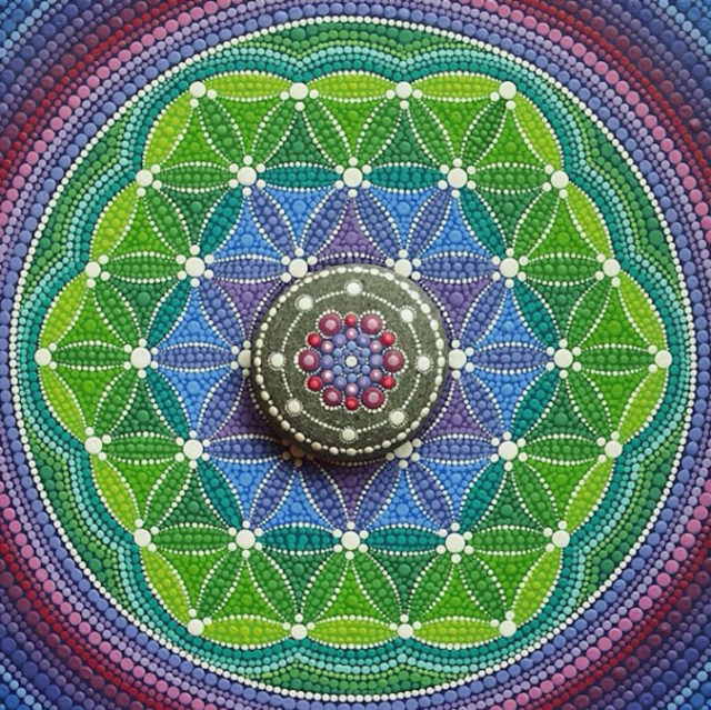 Red purple and white mandala stones.jpeg