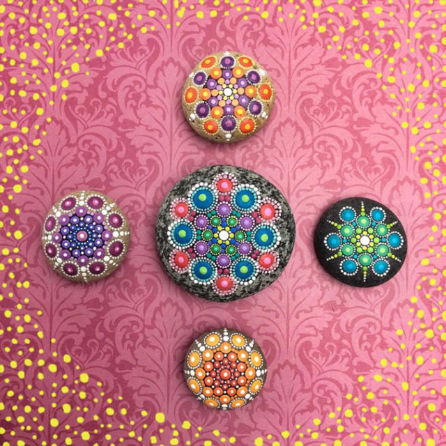 Vibrant colorful mandala stones.jpeg