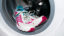Shoe washing. White and pink sneakers wash in the washer (automatic washing machine). How to clean sneakers