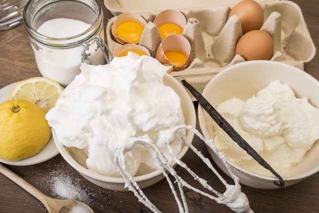 Bowl of beaten egg white and other baking ingredients of meringues on wooden table 499164753 58236dc45f9b58d5b1f31c74.jpg