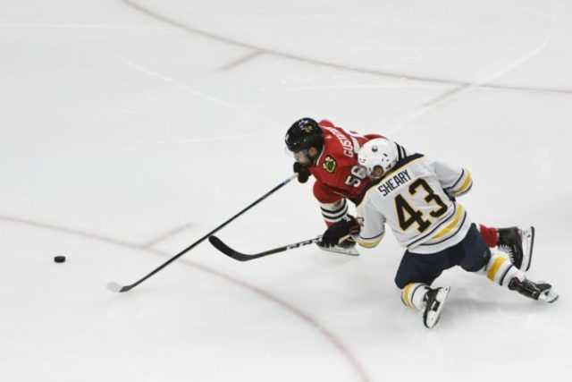 429552_erik gustafsson. conor sheary chicago blackhawks buffalo sabres nhl 676x451.jpg