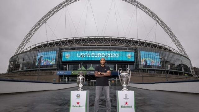 430756_henry with euro and ucl trophy with wembley arch backdrop 2 676x451.jpg