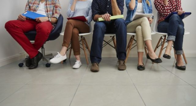 457418_candidates waiting job interview 676x367.jpg