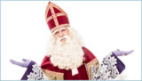 Sinterklaas portrait arms wide. isolated on white background with vintage look. Dutch character of Santa Claus