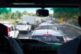 Driving minivan, traffic jam ahead, blurred shot with particular focus
