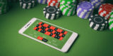 Casino chips and smartphone on green felt. 3d illustration