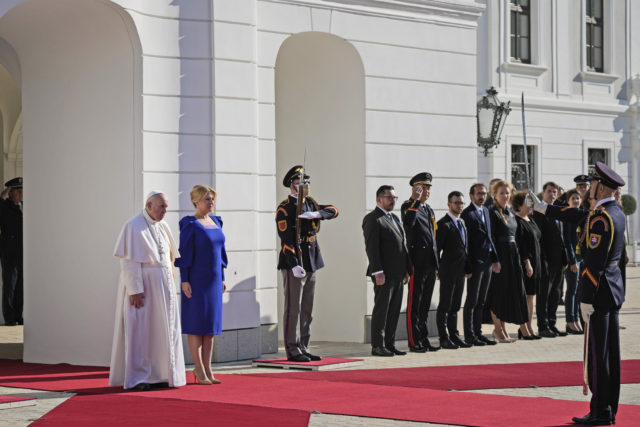 Pope Francis, flanked by Slovakian President Zuzana Caputova, right, attends a welcoming ceremony at the presidential palace in Bratislava, Slovakia, Monday, Sept. 13, 2021. Francis is on a four-day visit to Central Europe, in Hungary and Slovakia, in his first big international outing since undergoing intestinal surgery in July. ()