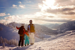 Happy family in winter clothing at the ski resort