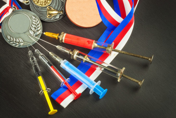 Syringe and medals. Doping in sport. Doping athletes.
