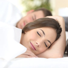Happy couple sleeping on a bed