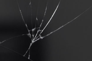 Crack on the glass of a smartphone or tablet, result of a fall or damage.