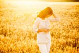 Beautiful brunette lady in wheat field at sunset_shutterstock_197635442.jpg