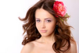 Pretty girl with long hair and flower hairpin