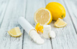 Vitamin C Tablets on wooden background; selective focus