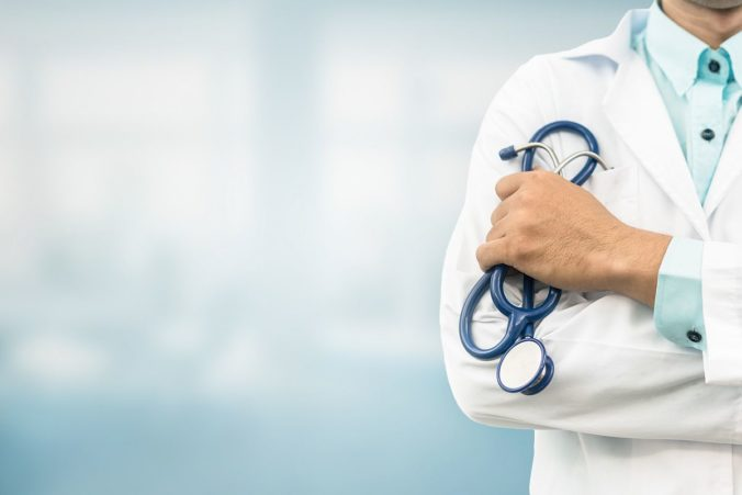 Doctor in hospital background with copy space
