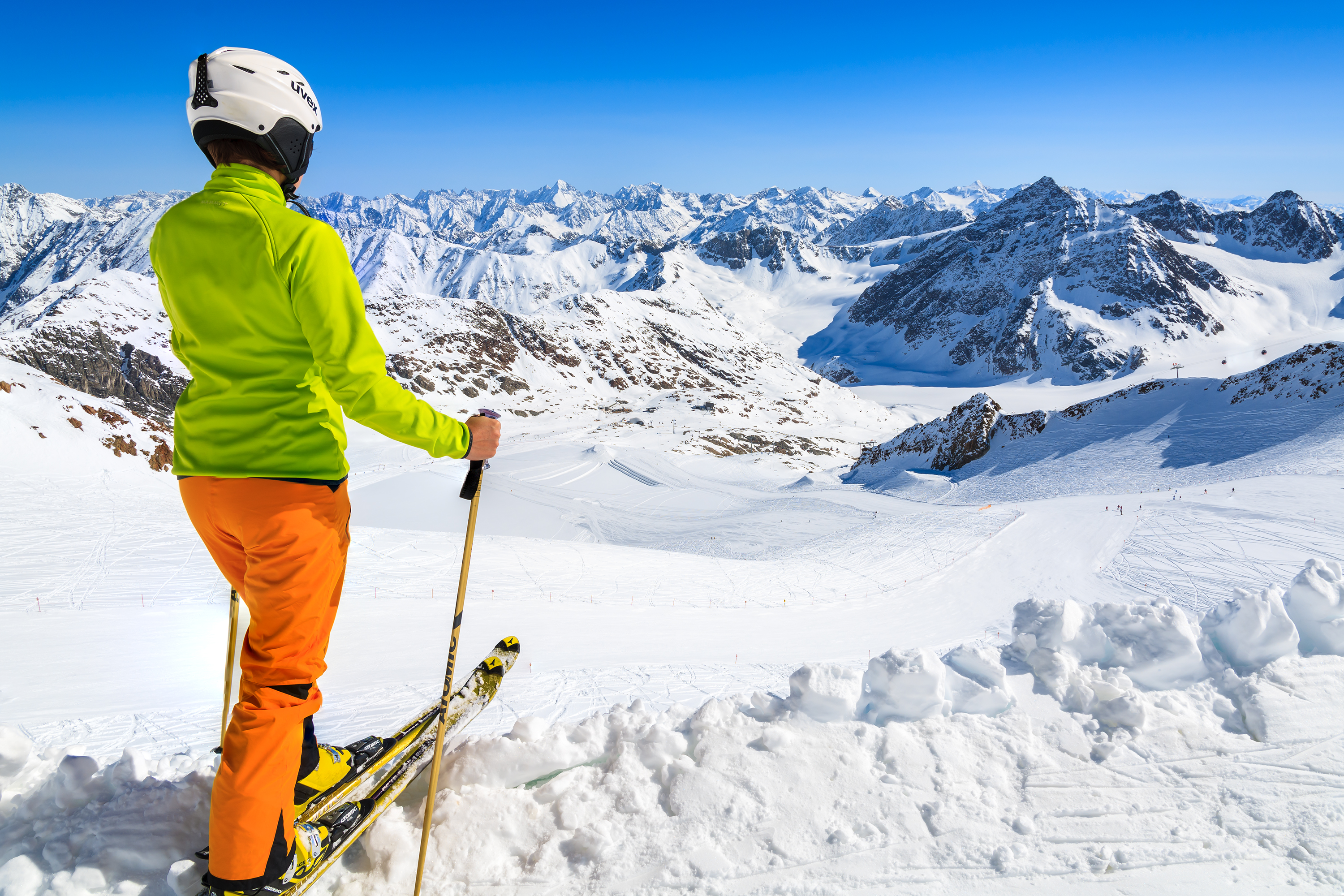 Woman skier on slope in the mountains of Pitztal winter resort