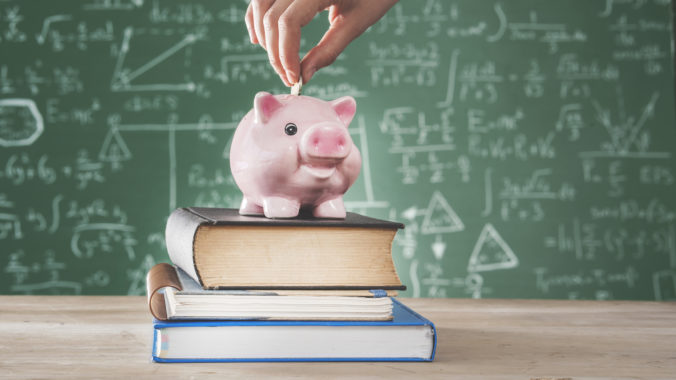 Female putting coin into piggy bank