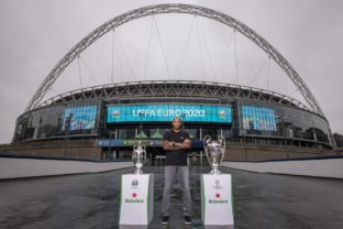 Henry with euro and ucl trophy with wembley arch backdrop 2.jpg