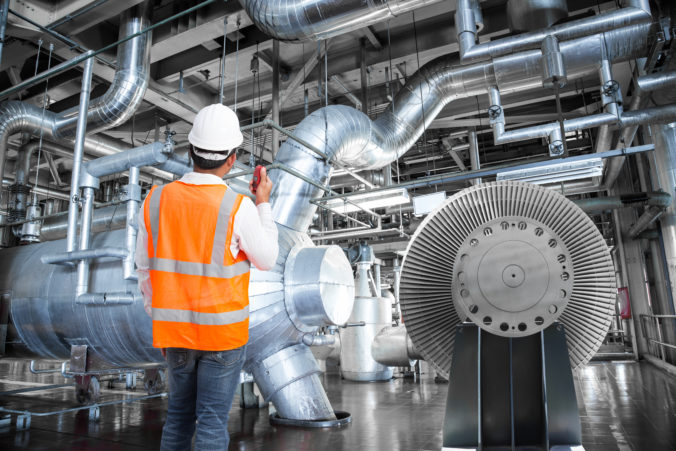 Engineer working in a thermal power plant with radio