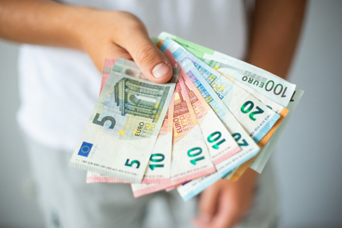 Man hands holding euro banknotes. Selective focus
