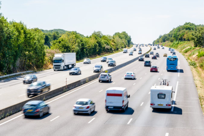 Heavy but fluid traffic on the A10 highway in France by a sunny day.