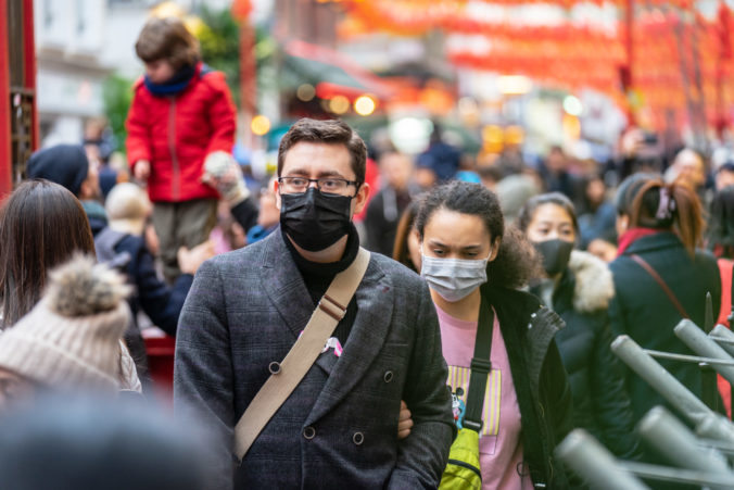 People wearing a face masks to protecting themself because of epidemic in China. Selective Focus. Concept of coronavirus quarantine.