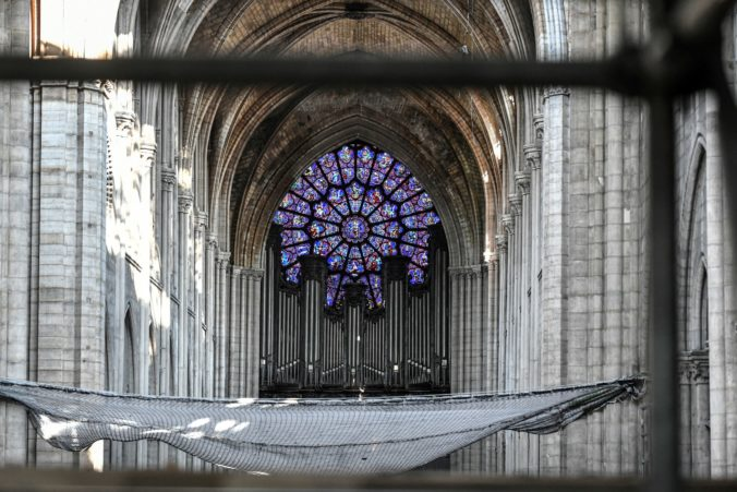 FILE - This July 17, 2019 file photo shows the big organ during preliminary work at the Notre-Dame de Paris, in Paris. Pipe by precious pipe, the organ that once thundered through fire-ravaged Notre Dame Cathedral is being taken apart. The mammoth task of dismantling, cleaning and re-assembling France's largest musical instrument started Monday Aug.3, 2020 and is expected to last nearly four years. (S)